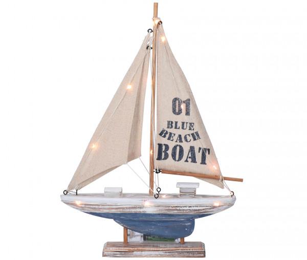 Tony Brown Segelboot mit Lichterkette